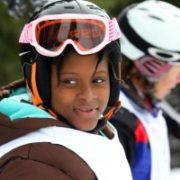 """Ornichleel """"Leel"""" Ulysse, a Haiti earthquake survivor, learning how to ski at The Hartford Ski Spectacular. (Photo: Business Wire)"""