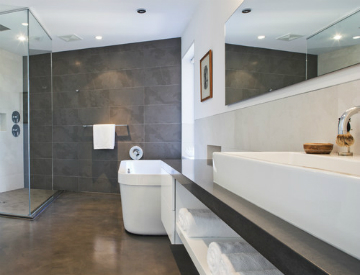 Concrete, pebble tile, and linoleum are three eco-friendly bathroom floor  materials that